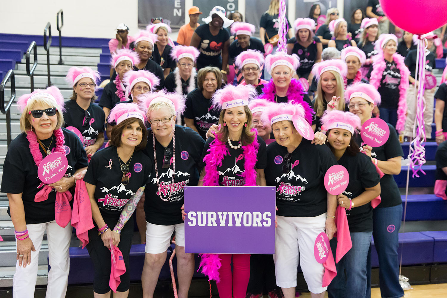 Ann Louden, leader and chair of TCU's Frogs for the Cure, surrounded by fellow breast cancer survivors at campus music video shoot.