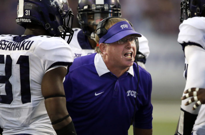 TCU head coach Gary Patterson talks with players during the first half of an NCAA college football game against Kansas State in Manhattan, Kan., Saturday, Oct. 10, 2015. (AP Photo/Orlin Wagner)