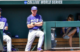 TCU head coach Jim Schlossnage perches on the top step of the TCU dugout deep in thought during the Horned Frog's 4-1 victory over Texas A&M. (Photo courtesy of GoFrogs.com)