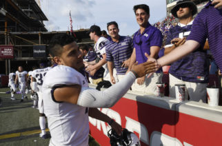 TCU quarterback Kenny Hill celebrates a win over Arkansas with fans after an NCAA college football game in Fayetteville, Ark., Saturday, Sept. 9, 2017.  (AP Photo/Michael Woods)