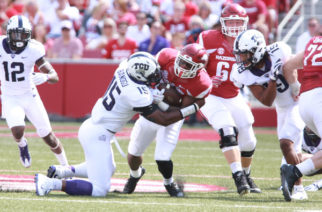TCU defensive end Ben Banogu (15) tackles Arkansas running back David Williams. Photo courtesy of GoFrogs.com