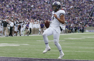 TCU quarterback Kenny Hill jogs into the end zone to give the Horned Frogs a 7-0 lead over Kansas State. Photo courtesy of GoFrogs.com
