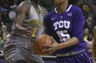 TCU guard Jayde Woods (15) drives against Baylor forward Dekeiya Cohen (1) during the first half of an NCAA college basketball game Saturday, Feb. 10, 2018, in Waco, Texas. (AP Photo/Jerry Larson)