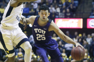 TCU guard Alex Robinson (25) drives while being defended by West Virginia guard Daxter Miles Jr. (4) during the first half of an NCAA college basketball game Monday, Feb. 12, 2018, in Morgantown, W.Va. (AP Photo/Raymond Thompson)