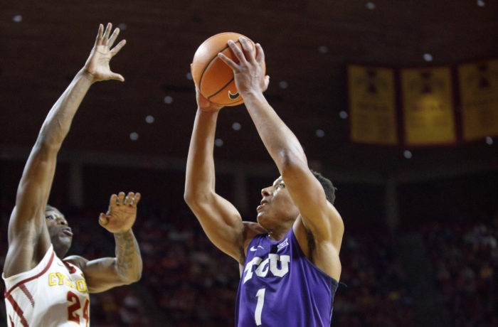 TCU's Desmond Bane (1) takes a shot past Iowa State's Terrence Lewis (24) during the first half of an NCAA college basketball game, Wednesday, Feb. 21, 2018, in Ames, Iowa. (AP Photo/Scott Morgan)
