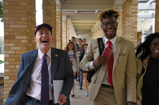Chancellor Victor Boschini accompanies Tristian Brooks to class as part of this year's big switch. (Photo by Shane Battis.)