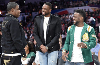 Actor Tracy Morgan, left, greets Dwyane Wade, center, of the Miami Heat, and actor Kevin Hart during the NBA All-Star basketball Three Point contest, Saturday, Feb. 17, 2018, in Los Angeles. (AP Photo/Chris Pizzello)