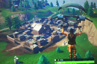 """In game """"Fortnite"""" action as a player parachutes down to where they will be their game."""