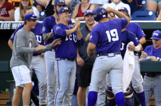 TCU's Luken Baker (19) celebrates with his teammates after hitting a home run against Coastal Carolina during the second inning of an NCAA College World Series baseball game, Tuesday, June 21, 2016, in Omaha, Neb. (AP Photo/Nati Harnik)